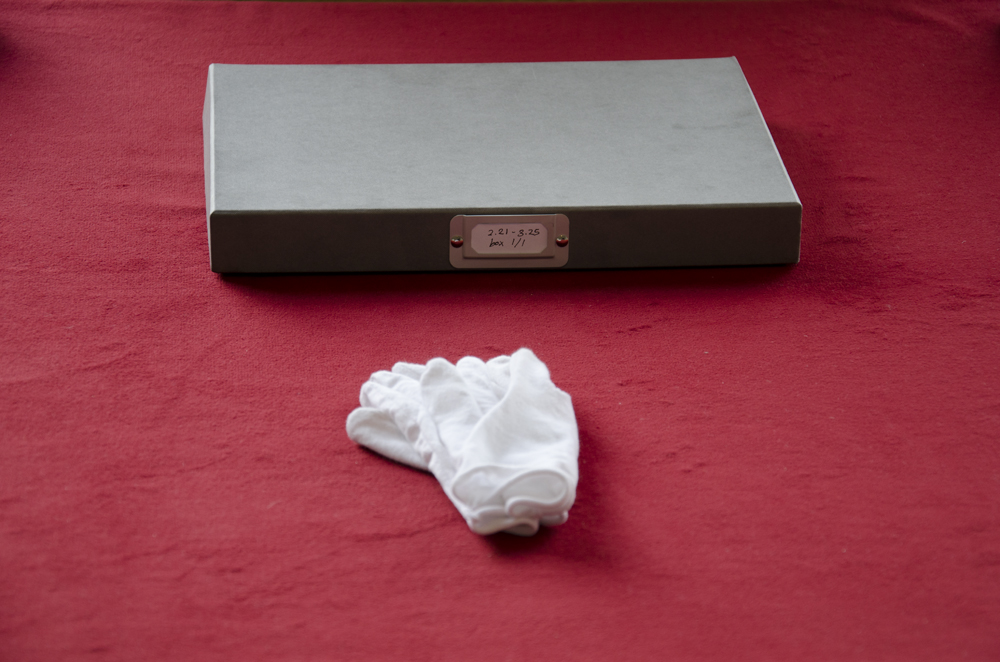 <em>The Said Woman,</em> archive box and gloves, 2014